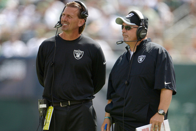 Sep 7, 2014; East Rutherford, NJ, USA; Oakland Raiders offensive coordinator Greg Olson (left) and offensive line coach Tony Sparano react during the game against the New York Jets at MetLife Stad ...