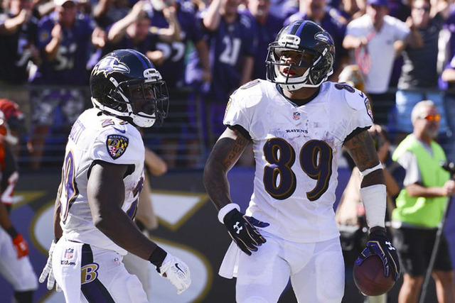 Sep 7, 2014; Baltimore, MD, USA; Baltimore Ravens wide receiver Steve Smith (89) celebrates with running back Justin Forsett (29) after scoring a touchdown during the fourth quarter against the Ci ...