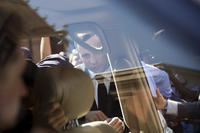 Olympic and Paralympic track star Oscar Pistorius leaves the North Gauteng High Court in Pretoria, Thursday, Sept. 11, 2014. A South African judge cleared Pistorius of all murder charges on Thursd ...
