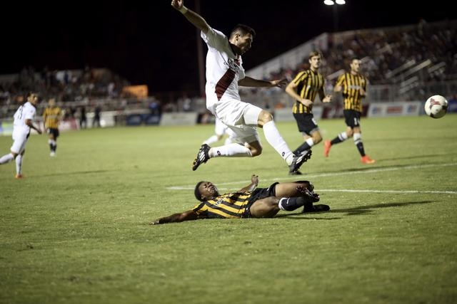 Host team Sacramento Republic FC (in white) and Charleston Battery compete in a soccer match at Bonney Field, the team's home ground, in Sacramento, California August 27, 2014. (REUTERS/Robert Gal ...