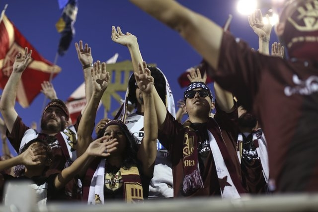 """Sacramento Republic FC fans known as """"The Battalion"""" cheer during the host team's game against Charleston Battery at Bonney Field, the team's home pitch, in Sacramento, California August 27, 2014. ..."""