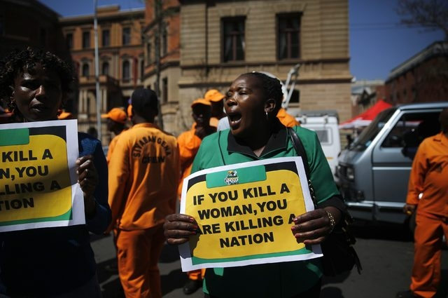 Members of the African National Congress Women's League protest outside the trial of South African Olympic and Paralympic sprinter Oscar Pistorius in Pretoria, Thursday, Sept. 11, 2014. A South Af ...