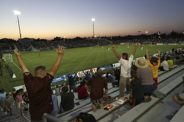 Sacramento Republic FC fans celebrate after the Republic scored a goal during its game against Charleston Battery at  Bonney Field, the team's home pitch, in Sacramento, California August 27, 2014 ...