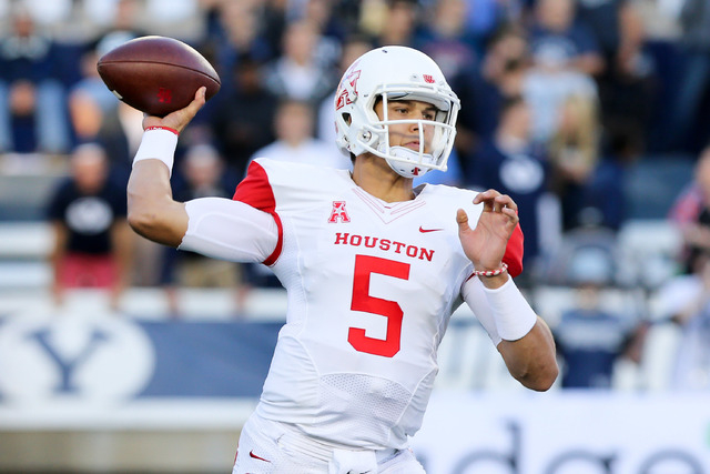 Houston Cougars quarterback John O'Korn (5) throws the ball down the field against the Brigham Young Cougars during the first quarter at Lavell Edwards Stadium on Sept. 11, 2014. (Chris Nicoll/USA ...