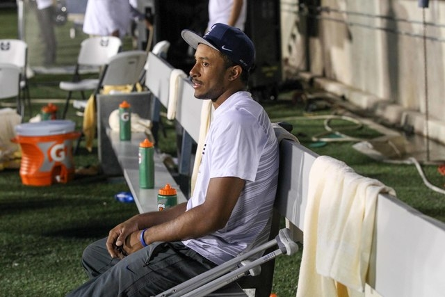 Utah State quarterback Chuckie Keeton sits on the bench during the second half after re-injuring his left knee against Wake Forest Demon on Sept, 13, 2014 at Romney Stadium in Logan, Utah. Utah St ...
