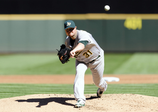 Sep 14, 2014; Seattle, WA, USA; Oakland Athletics starting pitcher Jon Lester (31) pitches to the Seattle Mariners during the first inning at Safeco Field. Mandatory Credit: Steven Bisig-USA TODAY ...