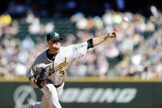 Sep 14, 2014; Seattle, WA, USA; Oakland Athletics starting pitcher Jon Lester (31) pitches to the Seattle Mariners during the fifth inning at Safeco Field. Mandatory Credit: Steven Bisig-USA TODAY ...