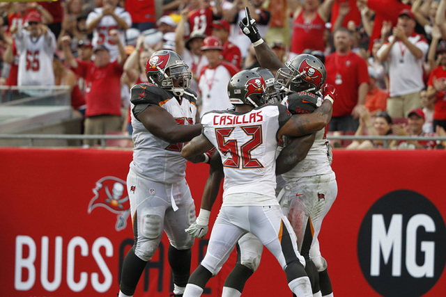 Sep 14, 2014; Tampa, FL, USA; Tampa Bay Buccaneers defensive tackle Clinton McDonald (98) is congratulated by teammates after he sacked St. Louis Rams quarterback Austin Davis (9) (not pictured) d ...