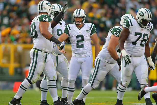 Sep 14, 2014; Green Bay, WI, USA; New York Jets kicker Nick Folk (2) is congratulated for kicking a field goal during the second half of a game against the Green Bay Packers at Lambeau Field. Gree ...