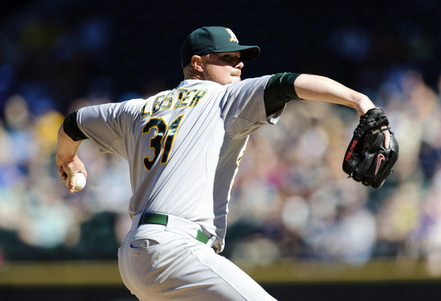 Sep 14, 2014; Seattle, WA, USA; Oakland Athletics starting pitcher Jon Lester (31) pitches to the Seattle Mariners during the second inning at Safeco Field. Mandatory Credit: Steven Bisig-USA TODA ...
