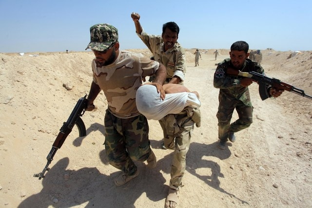 Shi'ite fighters, who have joined the Iraqi army to fight against militants of the Islamic State, formerly known as the Islamic State of Iraq and the Levant (ISIL), take part in field training in  ...