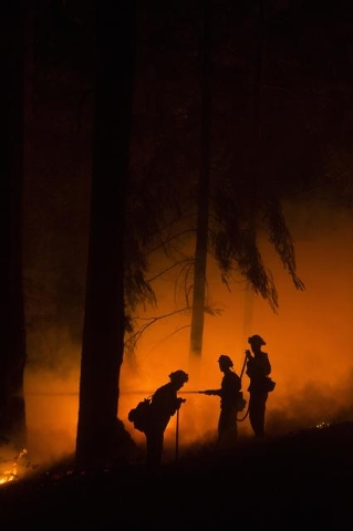 Firefighters battle the King Fire in Fresh Pond, California, Wednesday, Sept. 17, 2014. Fire crews in California's rugged Sierra Nevada are trying to gain the upper hand on Wednesday in a blaze th ...