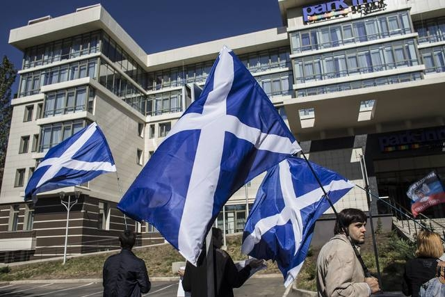 People hold Scotish flags during a rally in support of Scotland's independence referendum, in Donetsk, eastern Ukraine, Thursday, Sept. 18, 2014. (Reuters/Marko Djurica)