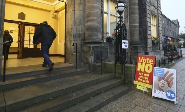 People arrive to cast their vote at Portobello Town Hall near Edinburgh, Scotland, Thursday, Sept. 18, 2014. Polling in the referendum on Scottish independence began on Thursday morning, as Scotla ...