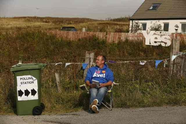 "A ""Yes"" campaigner sits outside the Waternish polling station on the Isle of Skye, Thursday, Sept. 18, 2014. Polling in the referendum on Scottish independence began on Thursday morning, as Scotla ..."