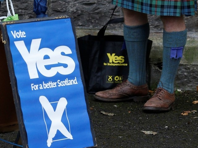 "A supporter of the ""Yes"" campaign stands outside a polling station during the referendum on Scottish independence in Pitlochry, Scotland, Thursday, Sept. 18, 2014. Polling in the referendum on Sco ..."