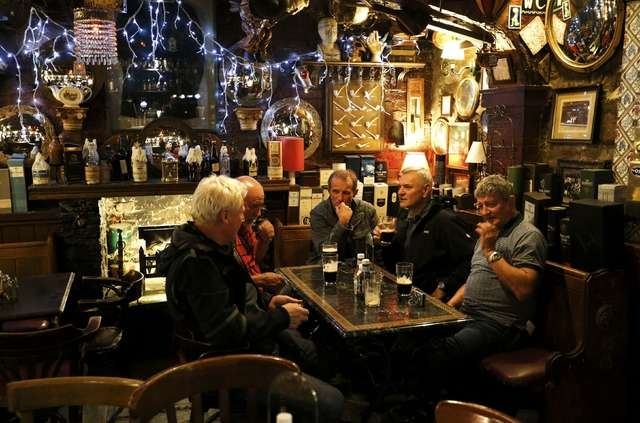 Patrons have a drink at Dirty Dick's pub as they wait for the result of the referendum in Edinburgh, Scotland, Thursday, Sept. 18, 2014. Scotland voted on Thursday on whether to stay within the Un ...