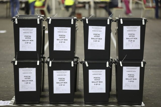 Ballot boxes wait to be opened at a counting centre in Edinburgh, Scotland, Thursday, Sept. 18, 2014. Scotland voted on Thursday on whether to stay within the United Kingdom or end the 307-year-ol ...