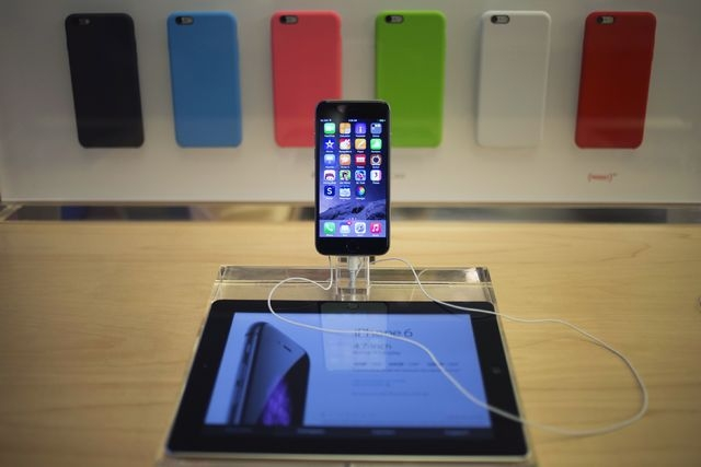 An iPhone 6 phone is seen on display at the Fifth Avenue Apple store on the first day of sales in Manhattan, New York, Friday, Sept. 19, 2014. Apple says it sold 10 million iPhone 6 and iPhone 6 P ...