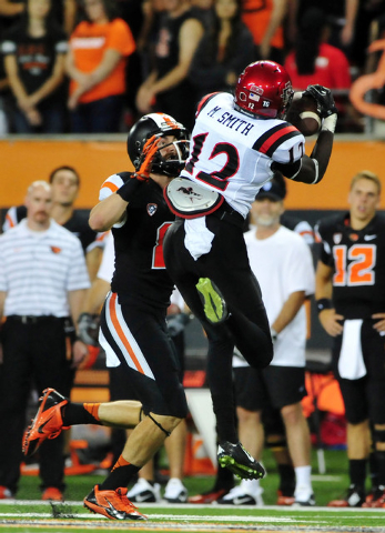 Sep 20, 2014; Corvallis, OR, USA;   San Diego State Aztecs defensive back Malik Smith (12) intercepts a pass against the Oregon State Beavers in the fourth quarter at Reser Stadium. The Oregon Sta ...