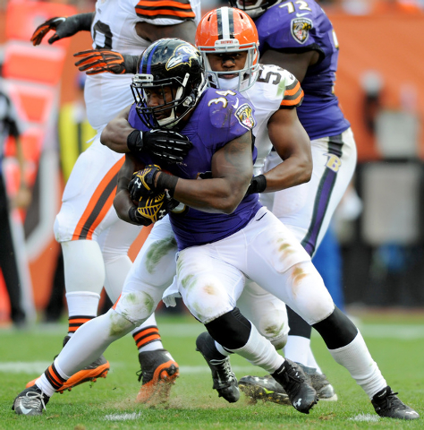 Sep 21, 2014; Cleveland, OH, USA; Baltimore Ravens running back Lorenzo Taliaferro (34) is taken down by Cleveland Browns inside linebacker Craig Robertson (53) during the third quarter at FirstEn ...
