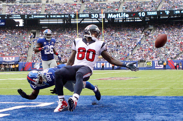 Sep 21, 2014; East Rutherford, NJ, USA; New York Giants cornerback Prince Amukamara (20) commits pass interference on a pass intended for Houston Texans wide receiver Andre Johnson (80) during the ...
