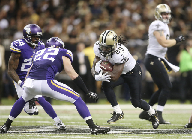 Sep 21, 2014; New Orleans, LA, USA; New Orleans Saints running back Khiry Robinson (29) carries the ball in front of Minnesota Vikings free safety Harrison Smith (22) in the second half at the Mer ...