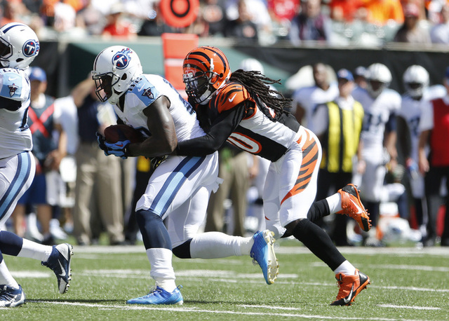Sep 21, 2014; Cincinnati, OH, USA; Cincinnati Bengals safety Reggie Nelson (20) tackles Tennessee Titans tight end Delanie Walker (82)  in the first half at Paul Brown Stadium. Cincinnati defeated ...