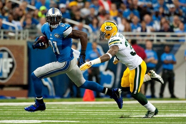 Green Bay Packers cornerback Sam Shields (37) tackles Detroit Lions wide receiver Calvin Johnson (81) during the second quarter at Ford Field. (Tim Fuller-USA TODAY Sports)