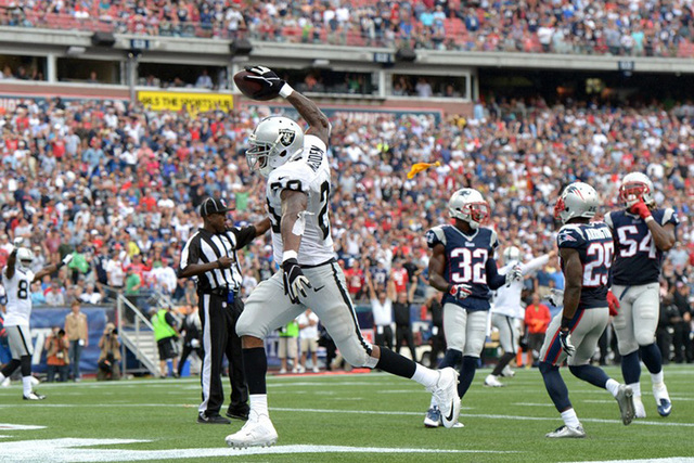 Oakland Raiders running back Darren McFadden (20) celebrates after a touchdown that was nullified by a holding penalty in the fourth quarter against the New England Patriots at Gillette Stadium. T ...