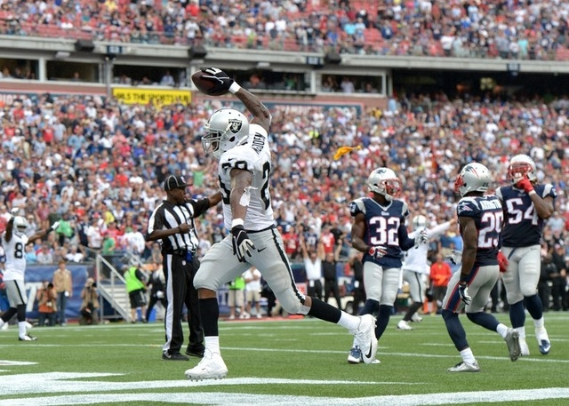 Sep 21, 2014; Foxborough, MA, USA; Oakland Raiders running back Darren McFadden (20) celebrates after a touchdown that was nullified by a holding penalty in the fourth quarter against the New Engl ...
