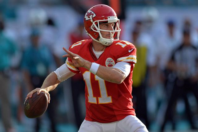 Sep 21, 2014; Miami Gardens, FL, USA; Kansas City Chiefs quarterback Alex Smith (11) throws a pass against the Miami Dolphins during the second half at Sun Life Stadium. Chiefs won 34-15. (Steve M ...