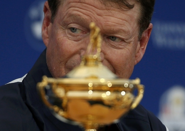 U.S. Ryder Cup captain Tom Watson sits with the Ryder Cup during a news conference ahead of the 2014 Ryder Cup at Gleneagles in Scotland September 22, 2014. (REUTERS/Russell Cheyne)