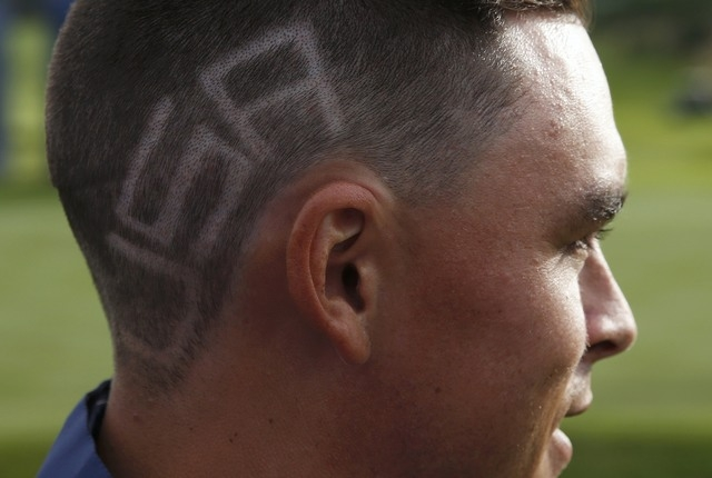 """The word """"USA"""" is seen on U.S. Ryder Cup player Rickie Fowler's hair, during practice ahead of the 2014 Ryder Cup at Gleneagles in Scotland September 22, 2014. (REUTERS/Russell Cheyne)"""