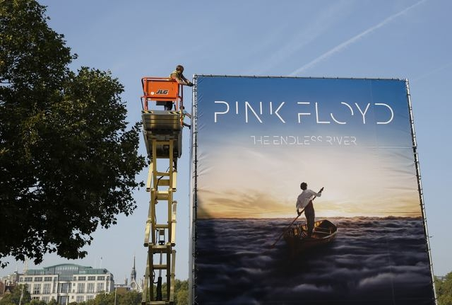 "Advertising for the new Pink Floyd album ""The Endless River"" is installed on a four sided billboard on the South Bank in London in this September 22, 2014 file photo. (REUTERS/Luke MacGregor)"