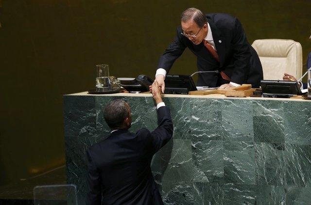 U.S. President Barack Obama is greeted by United Nations Secretary General Ban Ki-moon before addressing the 69th United Nations General Assembly at U.N. headquarters in New York, Wednesday, Sept. ...