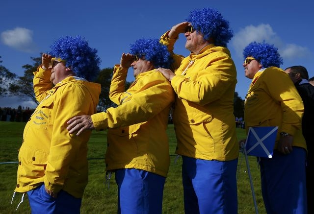 Swedish golf fans watch European Ryder Cup player Henrik Stenson during his fourballs 40th Ryder Cup match at Gleneagles in Scotland September 26, 2014. (Eddie Keogh/Reuters)