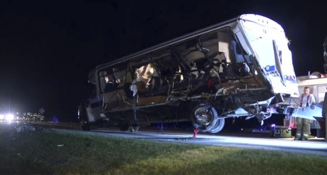The North Central Texas College bus that was involved in a crash is removed near Ardmore, Oklahoma, on Friday, Sept. 26, 2014, in this still image captured from KXAS TV video footage. Four members ...
