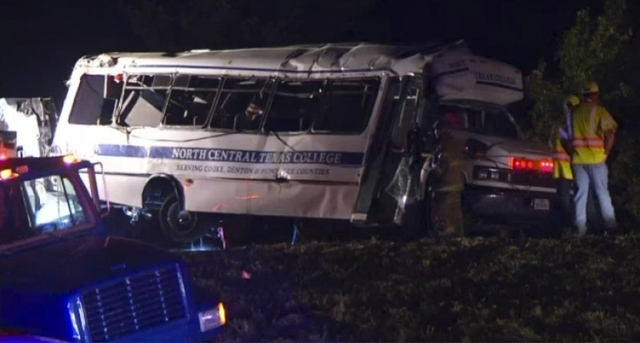 First responders tend to a North Central Texas College bus that was involved in a crash near Ardmore, Oklahoma, Friday, Sept. 26, 2014, in this still image captured from KXAS TV video footage. Fou ...