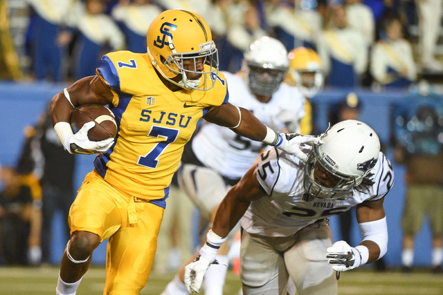 San Jose State wide receiver Tyler Ervin (7) runs with the football against UNR linebacker Bryan Lane Jr. (25) during a 21-10 loss to the Wolf Pack on Saturday. (Kyle Terada/USA TODAY Sports)
