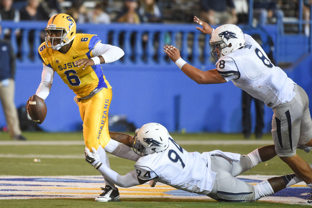 September 27, 2014; San Jose, CA, USA; San Jose State Spartans quarterback Joe Gray (6) is tackled by UR defensive end Lenny Jones (94) during a 21-10 loss to the Wolf Pack on Saturday. (Kyle Tera ...