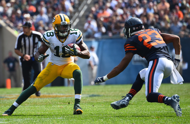 Sep 28, 2014; Chicago, IL, USA; Green Bay Packers wide receiver Randall Cobb (18) makes a catch against Chicago Bears cornerback Kyle Fuller (23) during the second half at Soldier Field.  The Gree ...
