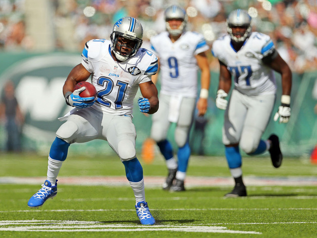 Sep 28, 2014; East Rutherford, NJ, USA; Detroit Lions running back Reggie Bush (21) carries the ball against the New York Jets during the second half at MetLife Stadium. The Lions won 24-17. (Adam ...