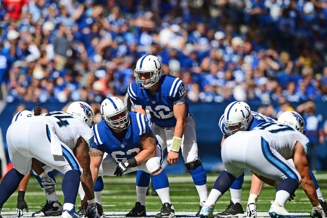 Sep 28, 2014; Indianapolis, IN, USA; Indianapolis Colts quarterback Andrew Luck (12) takes a snap from center during the third quarter against the Tennessee Titans at Lucas Oil Stadium. Colts defe ...