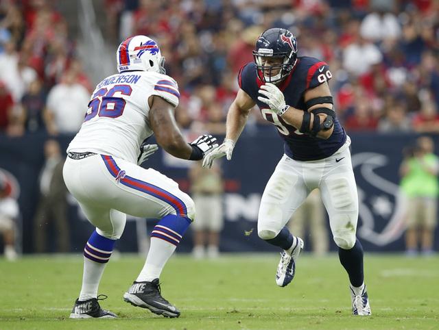 Sep 28, 2014; Houston, TX, USA; Houston Texans defensive end J.J. Watt (99) rushes against Buffalo Bills tackle Seantrel Henderson (66) during the game at NRG Stadium. (Kevin Jairaj-USA TODAY Sports)