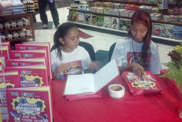 "Cianna and Izobel Sturges sign copies of their book, ""Las Vegas … Are We There Yet?"" Monday, Sept. 29, 2014, at one of the Hudson News stores at McCarran International Airport in Las Vegas,  ..."