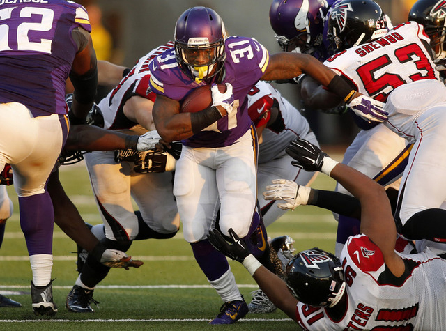 Sep 28, 2014; Minneapolis, MN, USA; Minnesota Vikings running back Jerick McKinnon (31) rushes against the Atlanta Falcons in the fourth quarter at TCF Bank Stadium. The Vikings win 41-28. (Bruce  ...