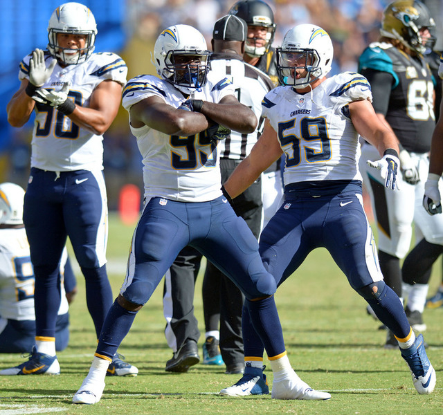 Sep 28, 2014; San Diego, CA, USA; San Diego Chargers defensive end Cordarro Law (99) reacts with inside linebacker Andrew Gachkar (59) and defensive tackle Ricardo Mathews (90) after sacking the q ...