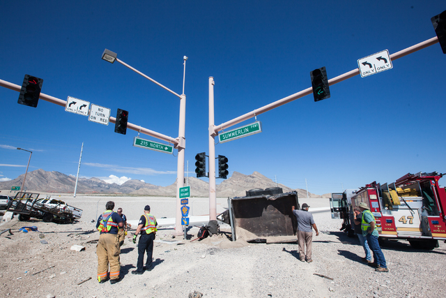 Nevada Highway Patrol and Las Vegas Fire and Rescue officials responded to a crash involving two landscaping trucks that caused one to catch fire at the Summerlin Parkway and 215 Beltway intersect ...