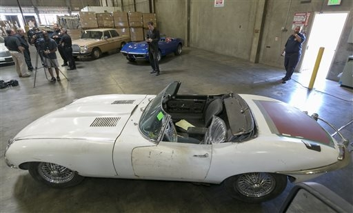A 1967 Jaguar XK-E convertible that was stolen 46 years ago is by the U.S. Customs and Protection agency in Carson, California, Wednesday, Sept. 17, 2014. The car was recovered at the Port of Long ...